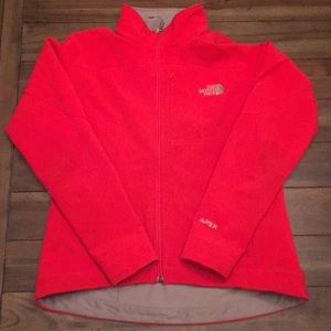 Bright orange/red north face jacket